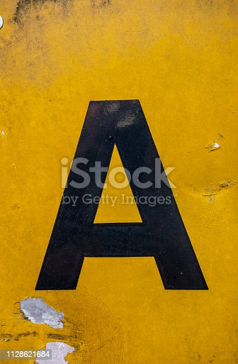 184953872istockphoto Written Wording in Distressed State Typography Found Letter A 1128621684