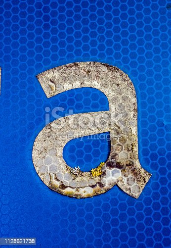 184953872istockphoto Written Wording in Distressed State Typography Found Letter A 1128621738