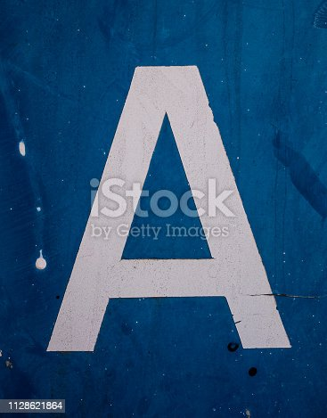 184953872istockphoto Written Wording in Distressed State Typography Found Letter A 1128621864