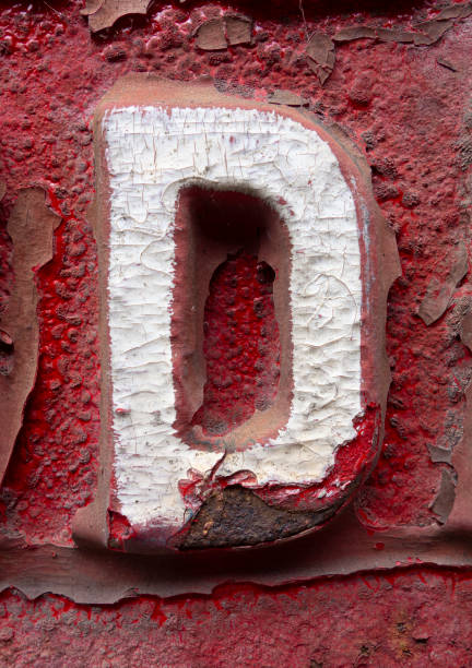 Written Wording in Distressed State Typography Found Letter D stock photo