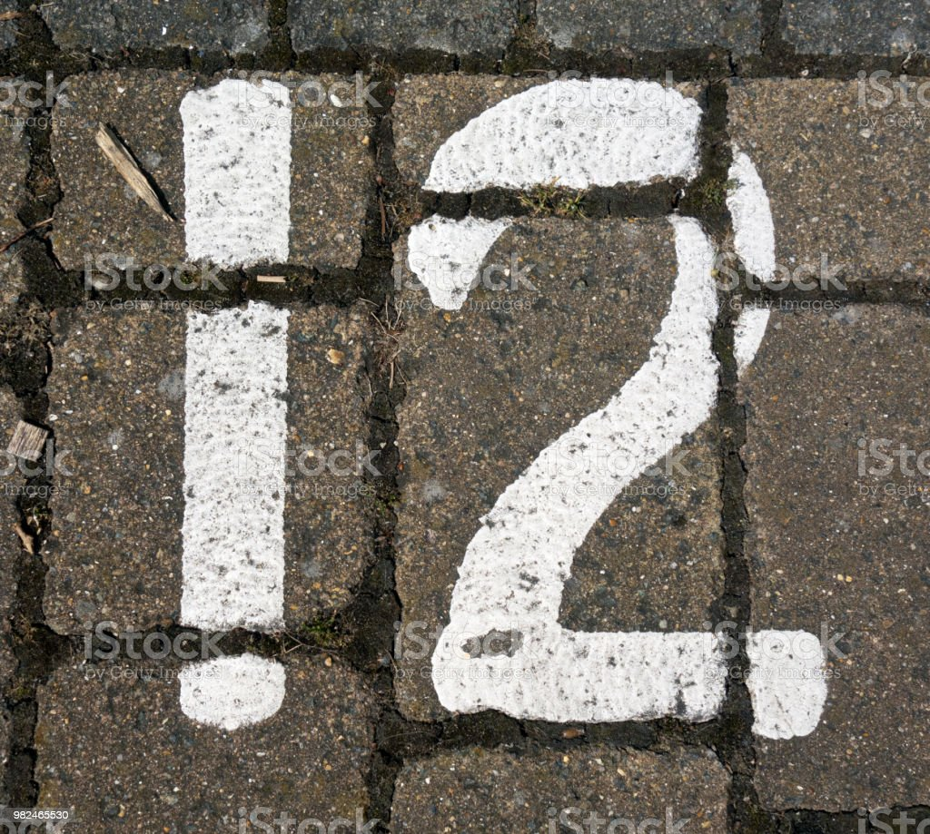 Written Wording in Distressed State Typography Found Number 12 Twelve stock photo