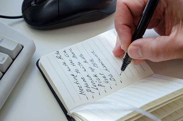 Writting on notepad stock photo