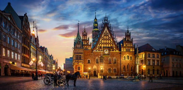 Wroclaw central market square with old houses, Town Hall and sunset, horse and carriage. stock photo