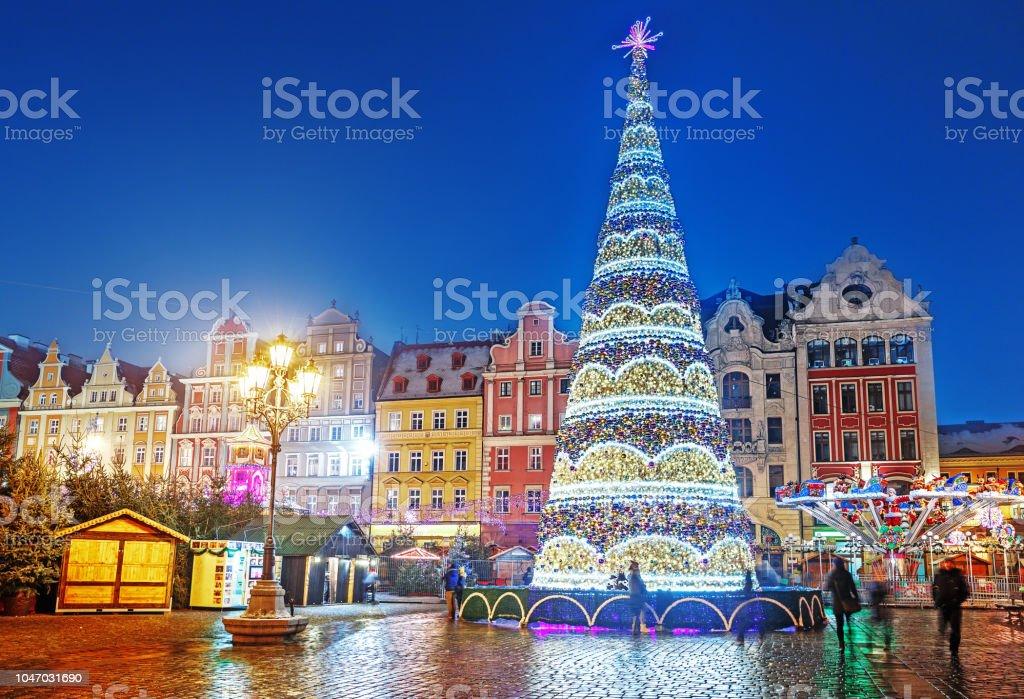 Wroclaw, Poland, Christmas market square and illuminated Christmas...