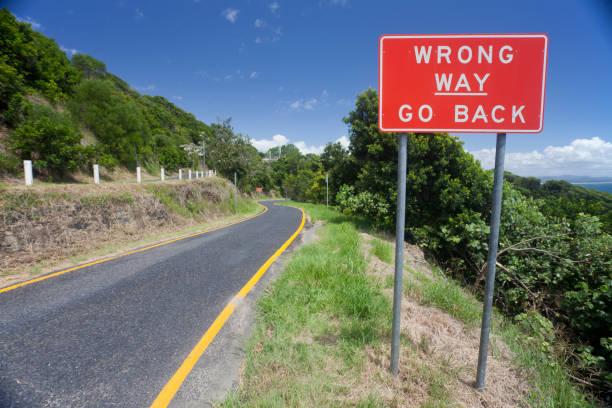 Wrong Way Go Back Sign stock photo