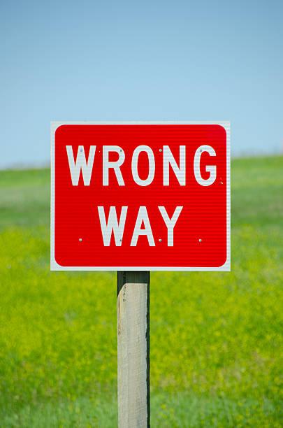 Wrong Way Street Sign stock photo