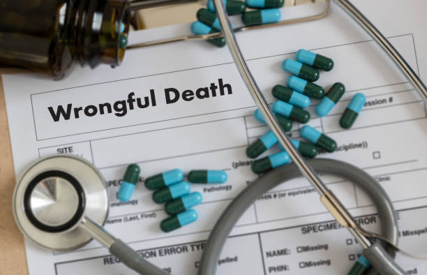 Wrongful Death Doctor talk and  patient medical working at office stock photo