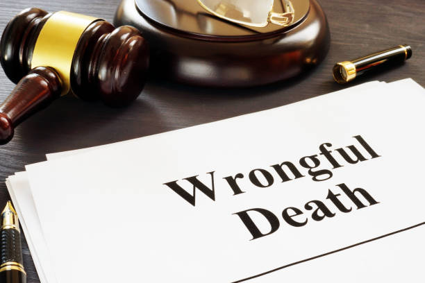 Wrongful Death report and gavel in a court. stock photo