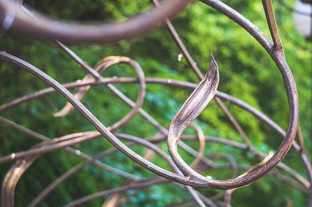 wrought bronze grille - garagen pergola stock-fotos und bilder