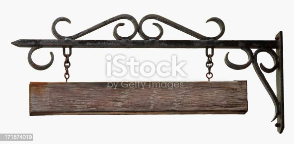 An old black hanging sign made from wrought iron with a blank wooden board hanging from chains.  Isolated on white.