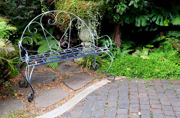 Wrought Iron Bench In The Garden Background Stock Photo More