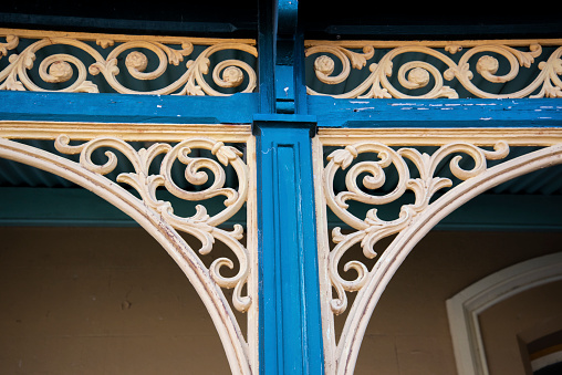 Wrought iron decoration on 19th century building.