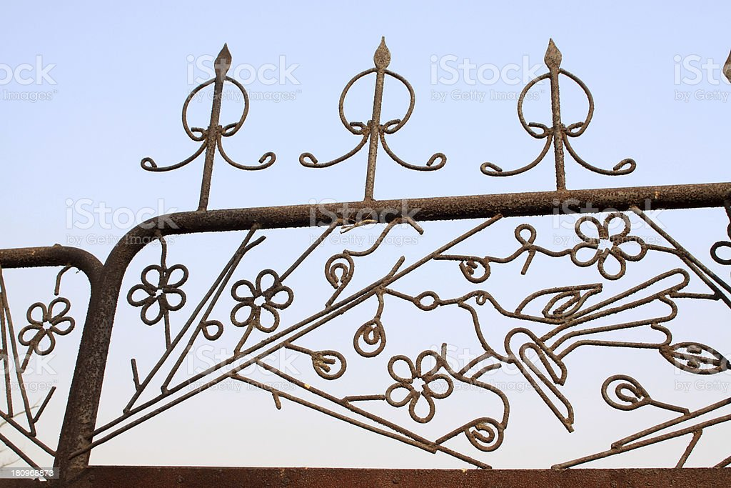 wrought iron design in the blue sky royalty-free stock photo