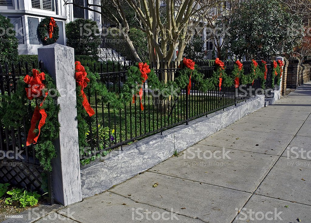 Wrought Iron Fence Decorated for Christmas royalty-free stock photo