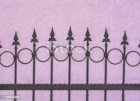 metal fence near wall