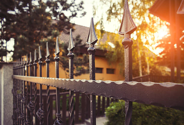 wrought iron fence - fence stock photos and pictures