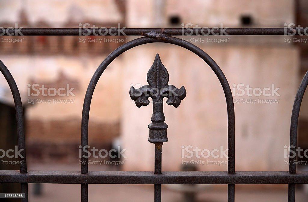 Wrought iron fence with Fleur de Lis motif stock photo