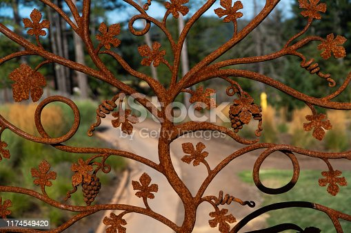 This is a wrought iron gate entrance near vineyards in Mendocino county.