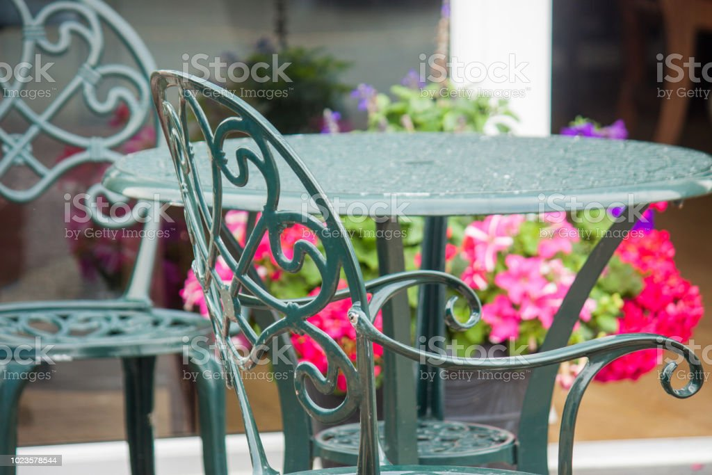 Wrought Iron table outside on a patio. stock photo