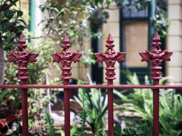 Wrought iron work fence - House stock photo