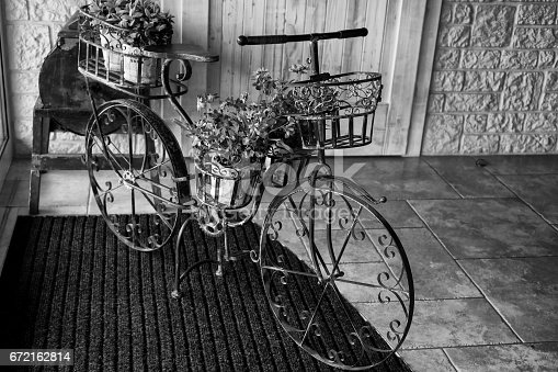 istock Wrought metal bicycle decoration. 672162814