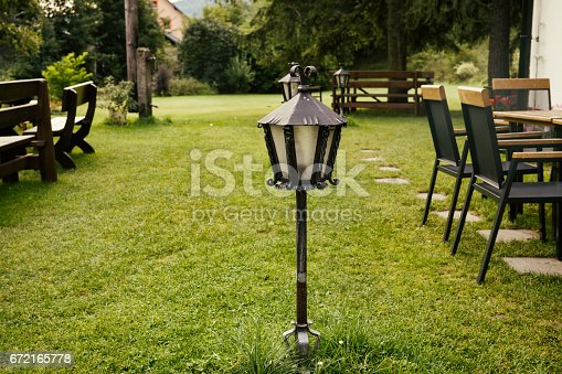 istock Wrought metal lamp decoration. 672165778