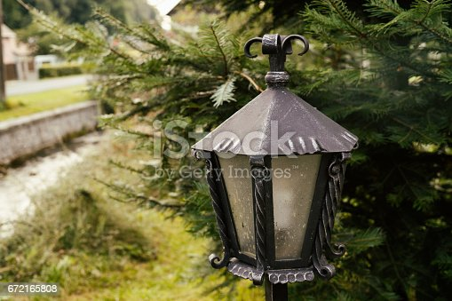 istock Wrought metal lamp decoration. 672165808