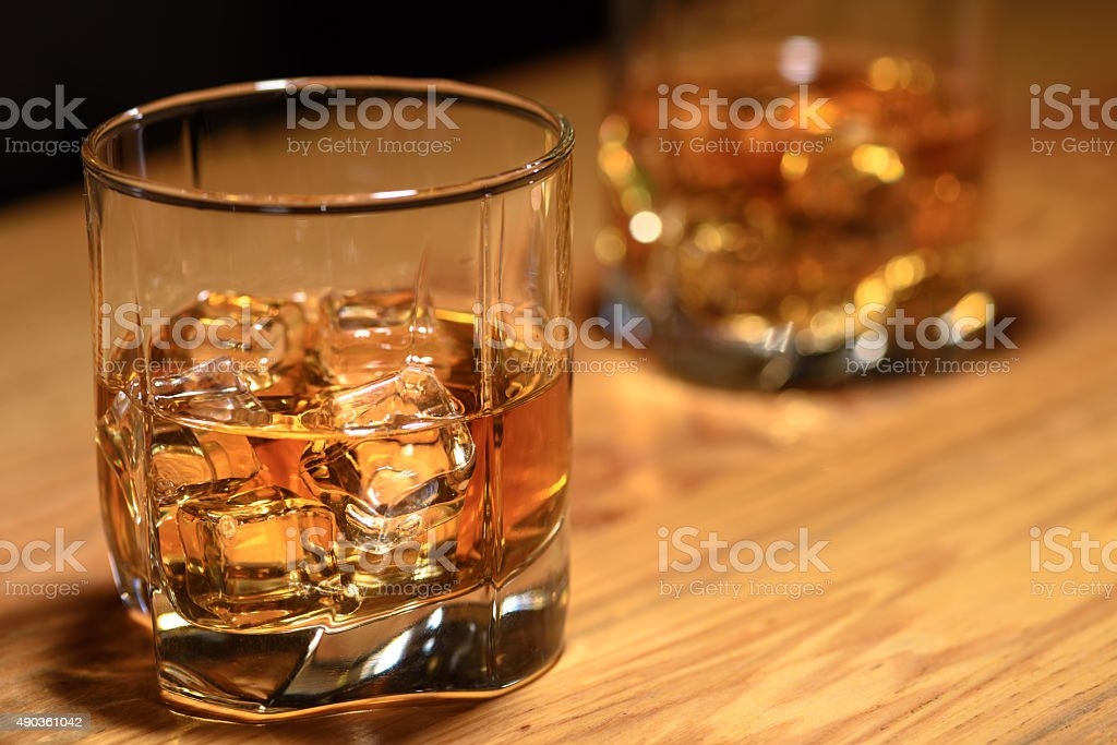 Wtill life of two whiskey glasses on the bar stock photo