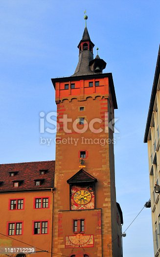 Würzburg, Lower Franconia, Bavaria, Germany: City Hall - Grafeneckart building - Rathaus - red tower with clock and sundial - the oldest surviving Romanesque secular building in the city. Located in the old town near the Vierröhrenbrunnen fountain.