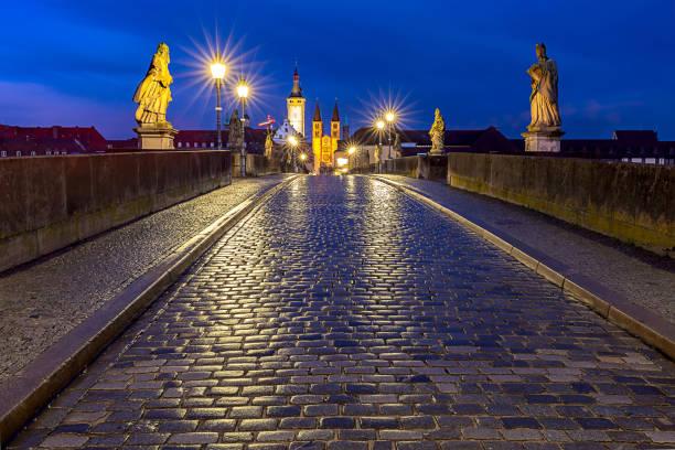 Wurzburg. Old stone bridge at sunset. stock photo