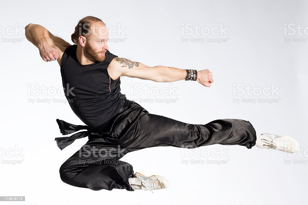 Wushu fighting position on gray royalty-free stock photo