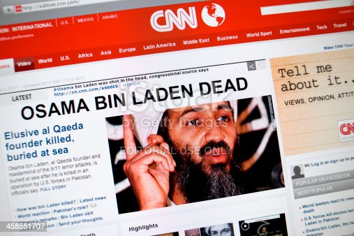 Wiesbaden, Germany - May 2, 2011: Close up of the www.cnn.com web pages show breaking news about the death of Osama bin Laden. The news says Osama was shot in the head and buried in the sea. Cable News Network (CNN) is a U.S.news channel headquartered in Atlanta, Georgia and founded in 1980 by Ted Turner. The browser is Safari 5