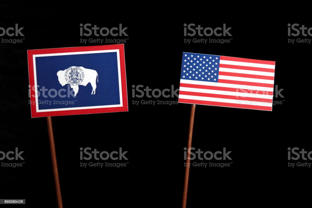 Wyoming flag with USA flag isolated on black background stock photo