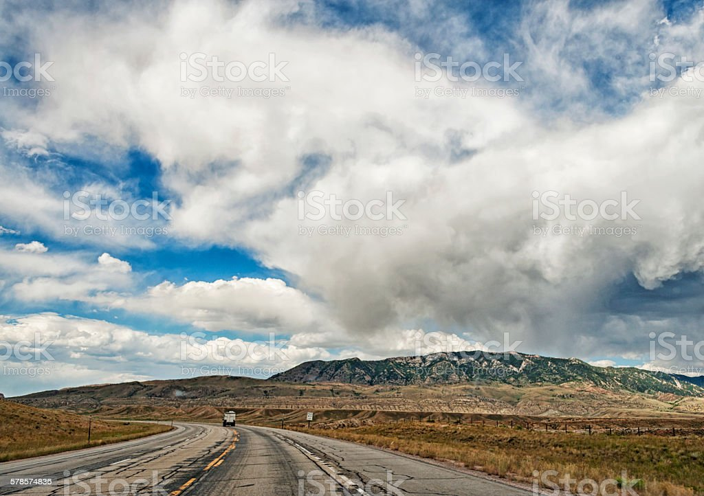 Wyoming Roadway to Casper with Clouds stock photo