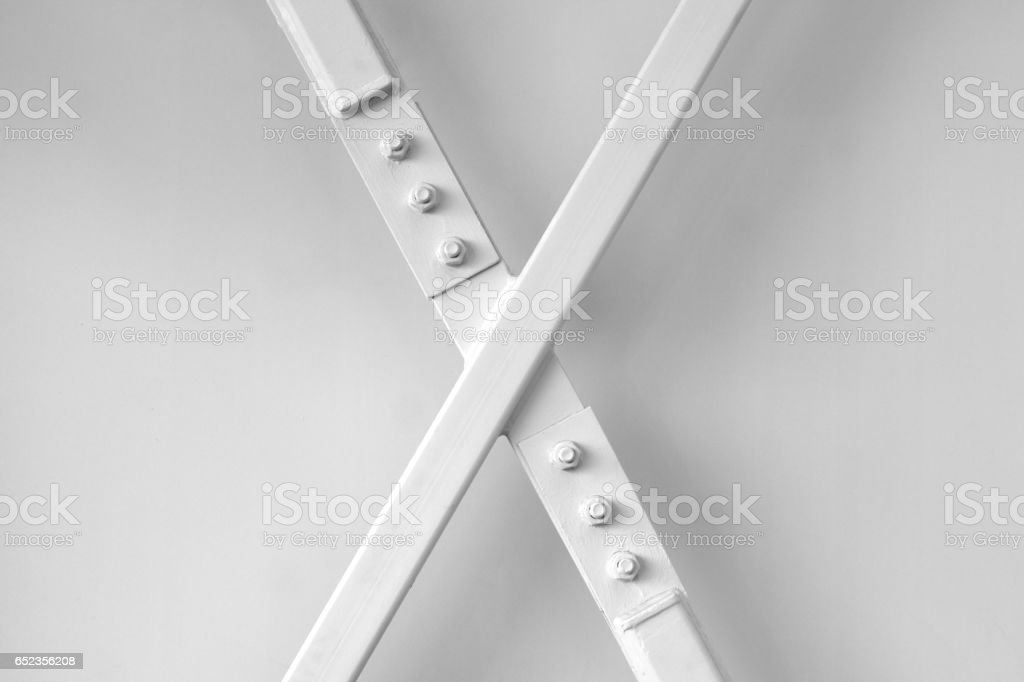 x letter painted beam metal structure shape stock photo