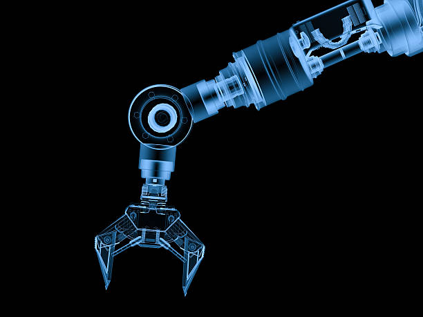 x ray robotic arm isolated on black stock photo