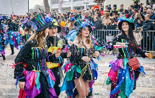 Xanthi, Greece - February 18, 2018: Group of tourist and Greek people celebrating on street in the annual Carnival Parade Festivali ( İskeçe Karnavalı) dressed in different colorful costumes. Over the last decades the Carnaval of Xanthi is one of the most important festivals of Carnival all over Greece in Rodopi, Xanthi.