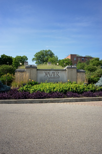 Cincinnati, Ohio, USA - August 8, 2015: Photograph of sign at the entrance to Xavier University Founded 1831.  Image taken at the roundabout on Ledgewood Road in Cincinnati.