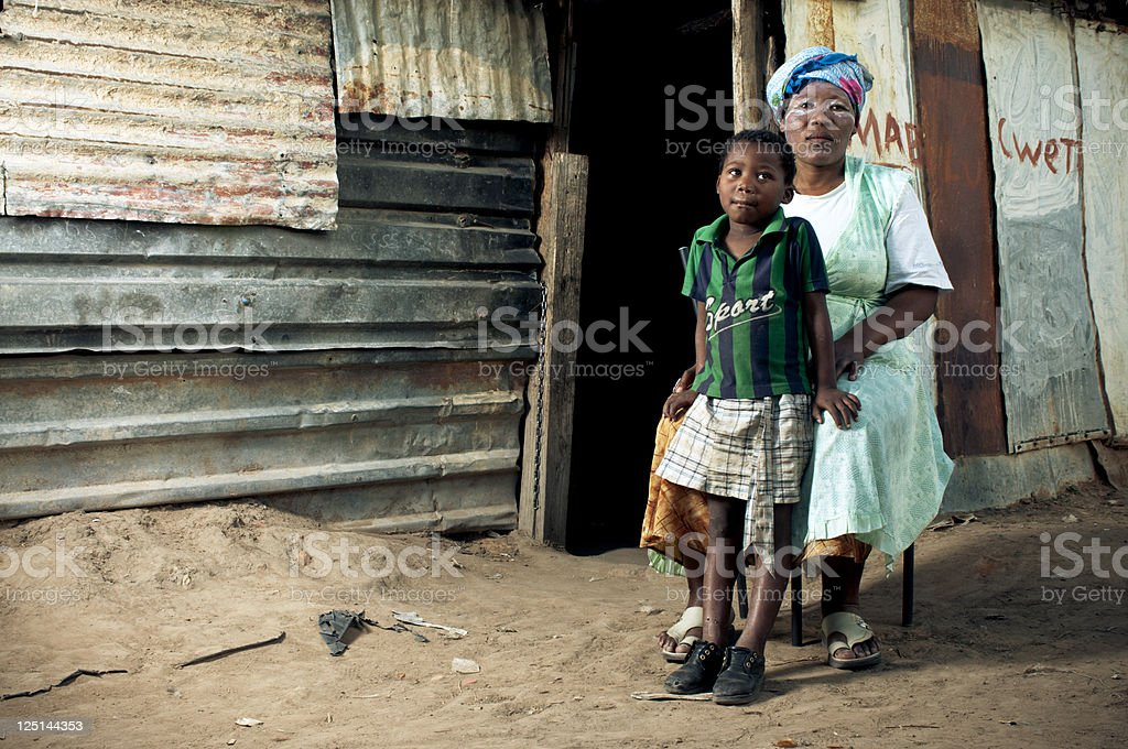 Xhosa family in front of house stock photo