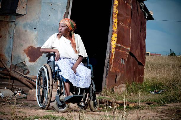 Xhosa woman in wheelchair stock photo