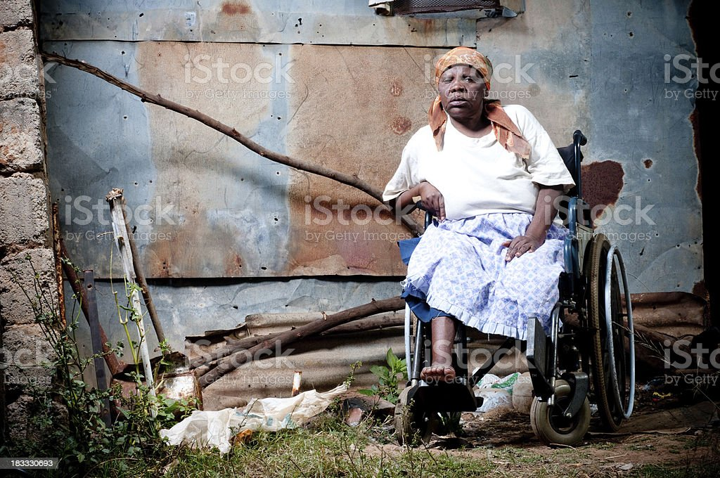 Xhosa woman in wheelchair stock photo