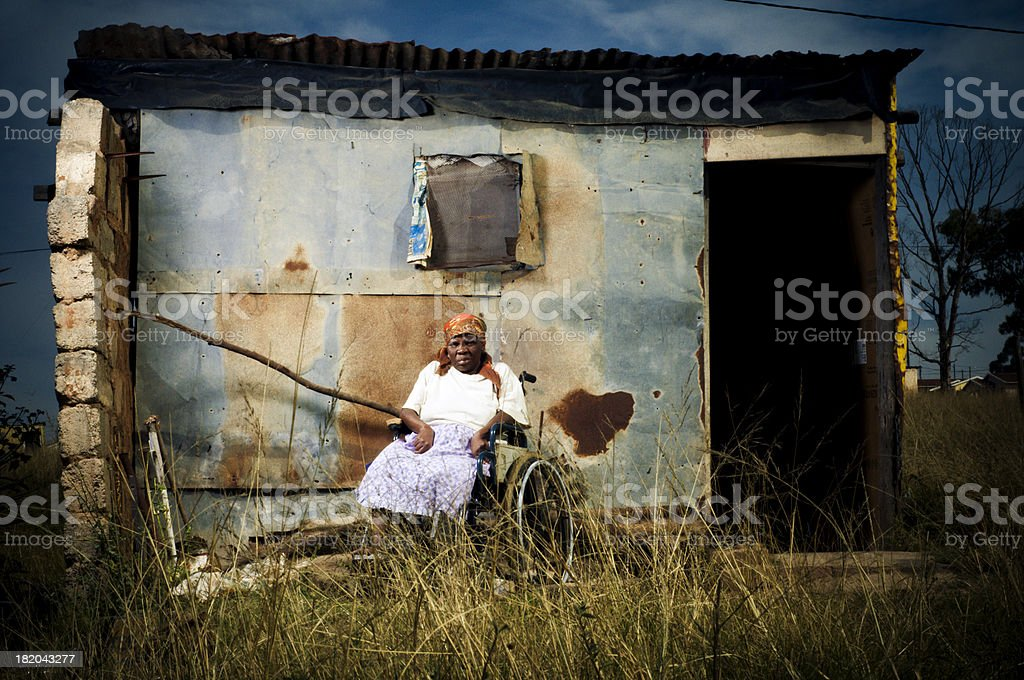 Xhosa woman infront of shelter stock photo
