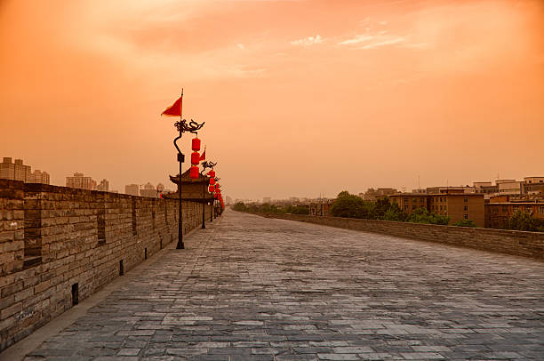 Xi'An City Wall, China Xi'An City Wall is one of the best and oldest wall in China. It is 14km long, 12m high and 12-14m wide at the top.   silk road stock pictures, royalty-free photos & images