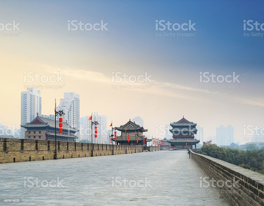 xian city wall with tower at dusk stock photo