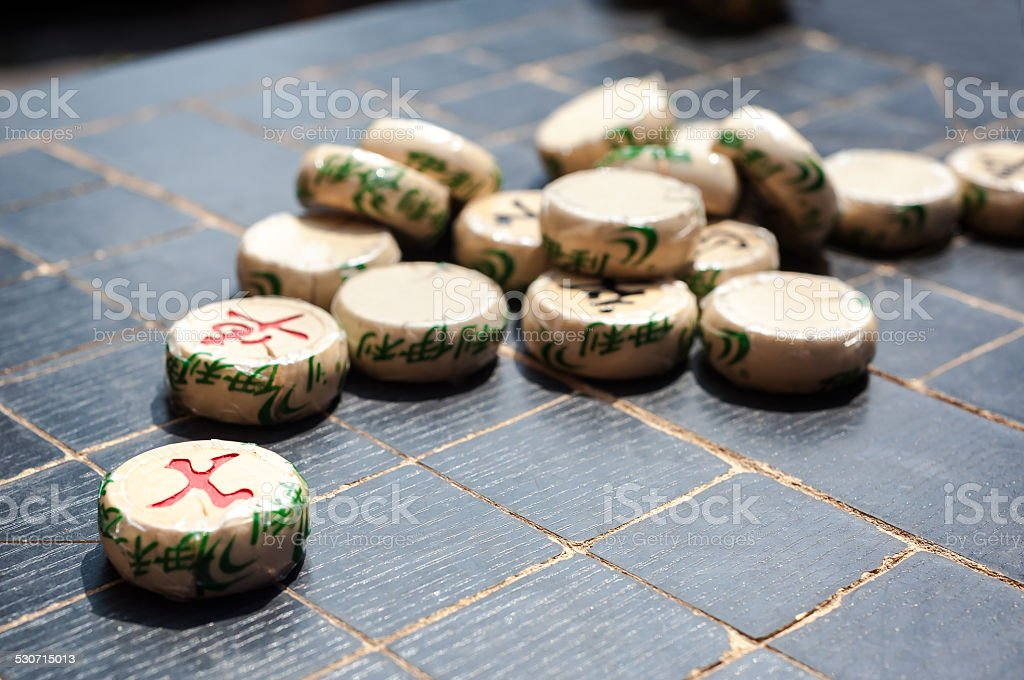 Xiangqi pieces on a Chinese chess board stock photo