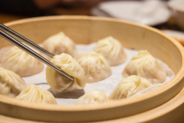 Xiaolongbao,steamed dumpling on the plate stock photo