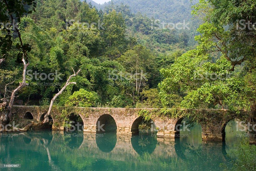 Xiaoqikong Bridge across tranquil river royalty-free stock photo