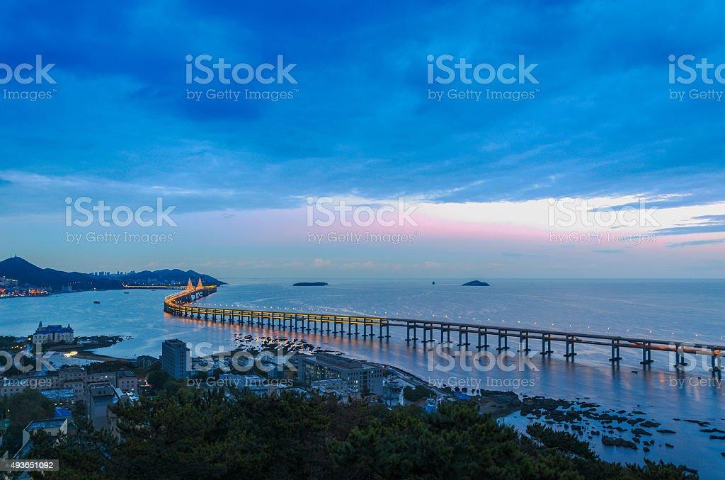 Xing Hai bay bridge bird view at dusk. stock photo
