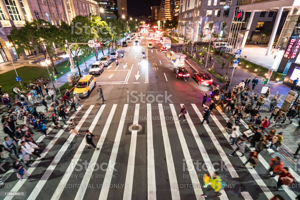 - Crowded of People crossing the street in Taipei city