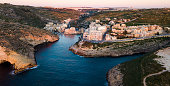 A typical winter sunset over Xlendi, Gozo.